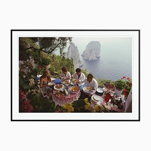 Dining Al Fresco On Capri C Print Framed in Black by Slim Aarons