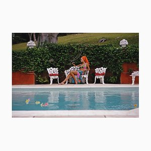 Lounging in Bermuda C Print Framed in White by Slim Aarons