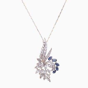 Collier avec pendentif en or blanc, diamants et saphirs, 1960