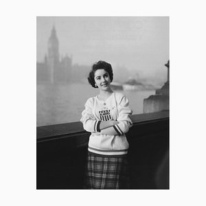 Elizabeth Taylor Standing in Front of the Houses of Parliament in London Archival Pigment Print Framed in White by Everett Collection