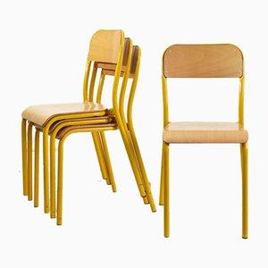Silla apilable de escuela francesa vintage curvada en amarillo, años 60