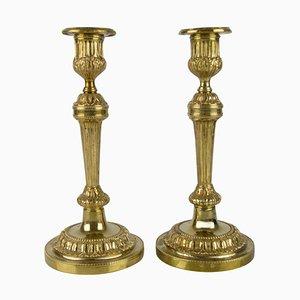 Candeleros franceses estilo neoclásico de bronce, años 20. Juego de 2