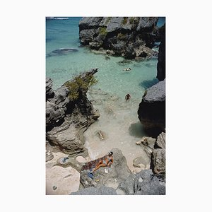 On the Beach in Bermuda Oversize C Print Framed in White by Slim Aarons