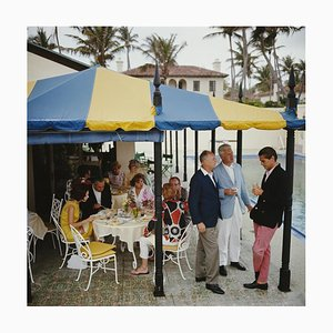 Palm Beach Party Oversize C Print Framed in White by Slim Aarons