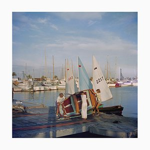 Sailing Dinghy Oversize C Print Framed in White by Slim Aarons