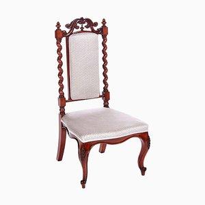 Antiker viktorianischer Stuhl aus geschnitztem Mahagoni