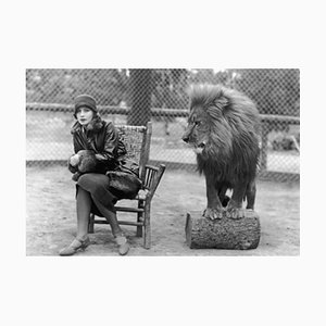 Greta & Leo the Lion at the Park Archival Pigment Print Framed in Black by Everett Collection