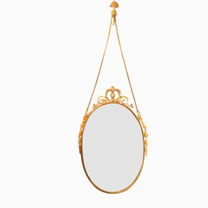 Vintage Oval Brass Mirror with Ornamental Decor