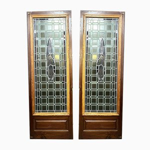 Puertas de vidrio teñido con representación de mujeres santas, años 40. Juego de 2