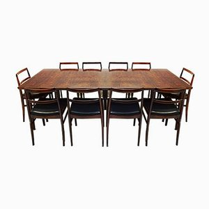 Juego de mesa y sillas extensible modelo 201 Modern danés de palisandro de Arne Vodder para Sibast, 1959. Juego de 13