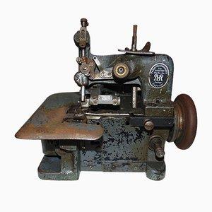 Máquina de coser antigua de Superior