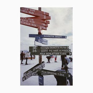 Signpost in St Moritz Oversize C Print Framed in White by Slim Aarons