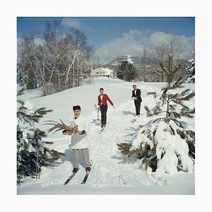 Skiing Waiters Oversize C Print Framed in Black by Slim Aarons