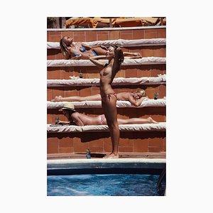 Sunbathing on Capri Oversize C Print Framed in Black by Slim Aarons