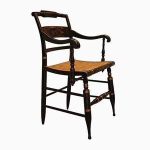 Butaca con estructura ebonizada y asiento de mimbre de Lambert Hitchcock para Hitchcock Chair Company