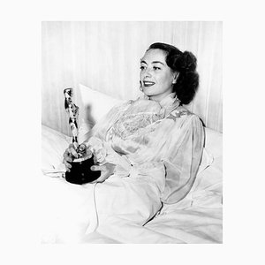 Joan Crawford in Bed with Oscar Archival Pigment Print Framed in White by Everett Collection