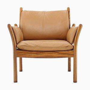 Danish Genius Leather & Rosewood Armchair by Illum Wikkelsø, 1960s