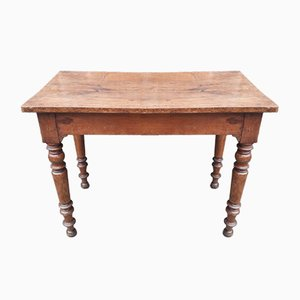 Mesa de bar antigua con patas torneadas