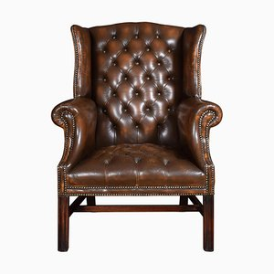 Brown Leather Upholstered Wingback Armchair, 1920s