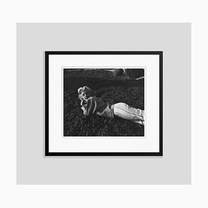 Marilyn Monroe Relaxing on the Grass Silver Gelatin Resin Print Framed in Black by Baron