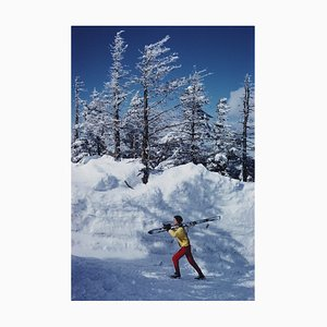 A Skier in Vermont Oversize C Print Framed in Black by Slim Aarons