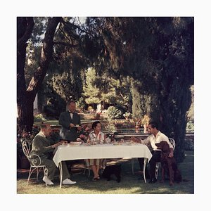 Al Fresco Tea Oversize C Print Framed in Black by Slim Aarons