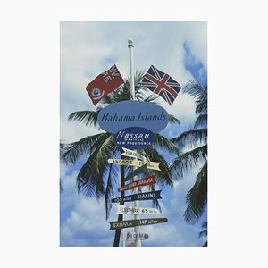Bahamas Signpost Oversize C Print Framed in White by Slim Aarons