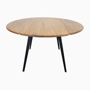 Black Leg Round Drop-Leaf Dining Table by Lucian Ercolani for Ercol, 1960s