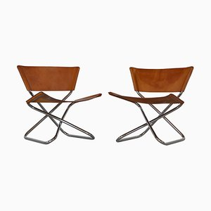 Danish Modern Lounge Chairs in Saddle Leather and Steel by Erik Magnussen, 1960s, Set of 2