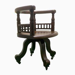 Chaise de Bureau Clerk Arts & Crafts Antique en Chêne avec Détails Sculptés et Socle en Fonte, 1900s