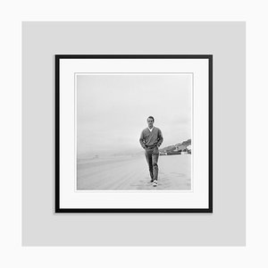 Paul Newman on the Beach Silver Gelatin Resin Print Framed in Black by Hulton Archive