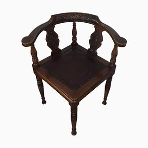 Antique Chair in Dark Wood with Floral Carvings