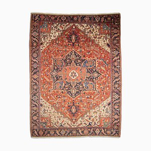 Geometric Rusty Red Heriz Rug with Border and Medallion, 1920s