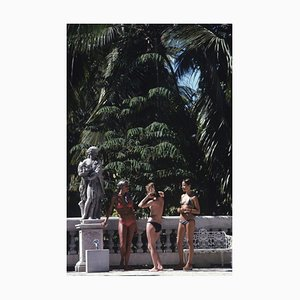 Bikinis in Haiti Oversize C Print Framed in Black by Slim Aarons