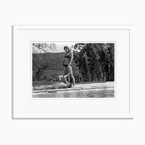 La Piscine Couple Archival Pigment Print Framed in White by Jean-Pierre Bonnotte