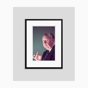 Alfred Hitchcock Holding a Cigar Framed in Black by Baron