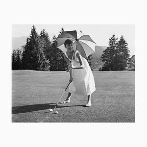 Golfing Hepburn Silver Gelatin Resin Print Framed In White by Hulton Archive