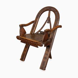 Russischer Armlehnstuhl aus geschnitztem Holz, 19. Jh