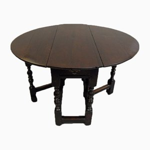 Antiker Eichenholz Tisch mit Torbeinen