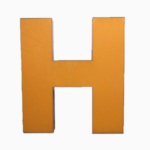Letra H industrial vintage grande naranja, años 70