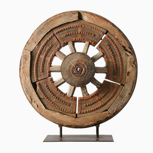 Antique Wooden Wheel on Iron Foot