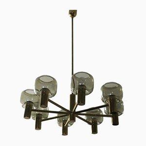 Lámpara de araña Mid-Century grande de latón y vidrio con ocho brazos de Hans-Agne Jakobsson