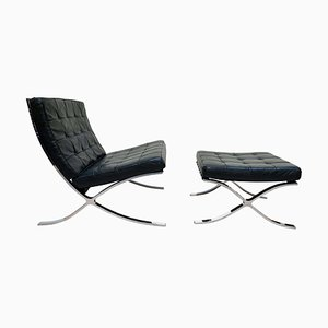 Barcelona Chair with Ottoman in Black Leather by Ludwig Mies van der Roh for Knoll International, 1960s, Set of 2