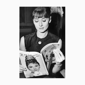 Audrey Reading Audrey Archival Pigment Print Framed In Black by Everett Collection