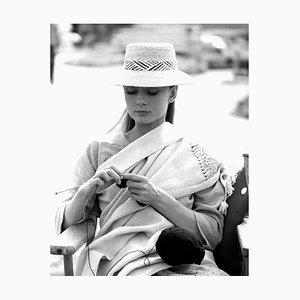 Audrey Hepburn Knitting In Between Scenes Archival Pigment Print Framed In Black by Everett Collection