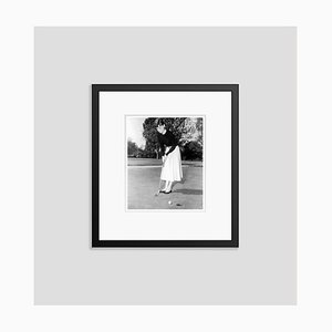 Audrey Hepburn Playing A Spot of Golf Archival Pigment Print Framed In Black by Everett Collection