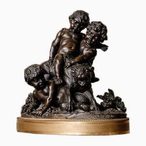 18th Century Bronze 3 Children Playing with a Feline Sculpture by Clodion