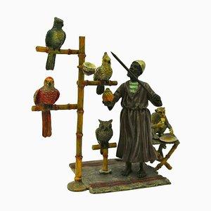 Bronze Man mit seinem Animals or Parrot Trainer