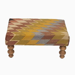 Small Turkish Kilim Ottoman With Wood Legs from Vintage Pillow Store Contemporary