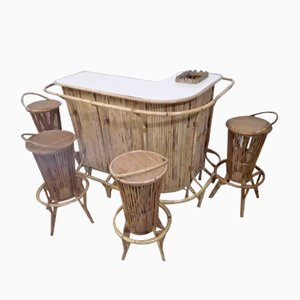 Mesa de bar de mimbre con taburetes, años 50. Juego de 5